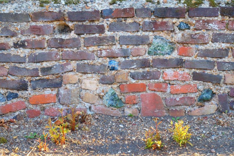 Bricks and mortar wall with glass blocks